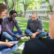 Group Of Students Using Digital Tablet On Campus — Stock Photo #40076263
