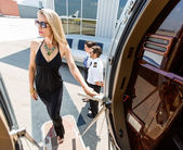 Beautiful Woman In Dress Boarding Private Jet — Stock Photo