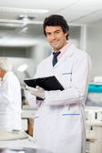 Technician With Clipboard In Laboratory — Stock Photo
