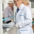 Stockfoto: Researcher Loading Samples In Analyzer