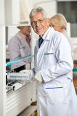 Researcher Loading Samples In Analyzer — Stock Photo