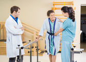 Female Patient Being Assisted By Physical Therapists — Stock Photo