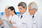 Researchers Discussing Over Clipboard — Foto Stock