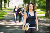 Smiling Student Standing On Campus Road — Foto Stock
