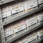 Racks Of Test Tubes On Shelves — Stock Photo #40352519