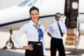 Beautiful Airhostess With Hand On Hip At Airport Terminal — Stock Photo