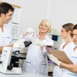 Scientists Discussing Over Blood Sample In Laboratory — Stock Photo