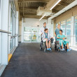 Medical Team Pushing Patients On Wheelchairs At Hospital Corrido — Stock Photo