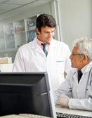 Technicians Discussing In Laboratory — Stock Photo