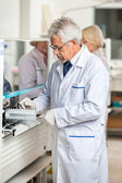 Technician Loading Analyzer With Samples — Stock Photo
