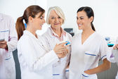 Researcher With Colleagues Discussing Over Medicines — Stock Photo
