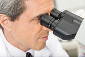 Scientist Using Microscope In Lab — Stock Photo