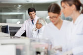 Male Technicians Discussing In Lab — Stock Photo
