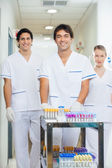 Technicians With Medical Cart In Hospital Corridor — Stock Photo