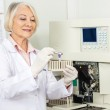 Scientist Analyzing Blood Sample In Laboratory — Stock Photo #40686913