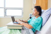Patient Using Laptop On Bed In Hospital — Stock Photo