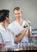 Happy Technicians Analyzing Sample In Lab — Stock Photo