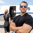 Bodyguard Standing Against WomAnd Private Jet — Stock Photo #40842249
