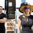 Beautiful Woman With Bodyguard Against Private Jet — Stock Photo #40842341