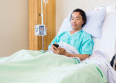 Patient Using Mobile Phone On Hospital Bed — Stock Photo
