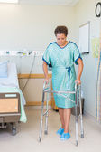 Patient Walking With The Help Of Walker In Hospital — Stock Photo