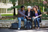 Happy University Students Using Digital Tablet On Campus — Stock Photo