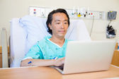 Patient Using Laptop On Hospital Bed — Stock Photo