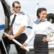 Airhostess With Pilot Boarding Private Jet — Stock Photo #41038175