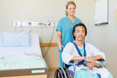 Mature Patient Sitting On Wheelchair While Nurse Assisting Him — Stock Photo