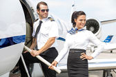 Airhostess With Pilot Boarding Private Jet — Stock Photo
