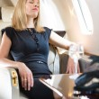 Woman With Eyes Closed Relaxing In Private Jet — Stock Photo