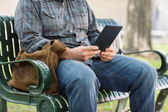 Midsection Of College Student Using Digital Tablet — Stock Photo