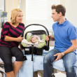 Couple With Baby Looking At Each Other On Hospital Bed — Stock Photo #41254439