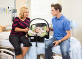 Couple With Baby Looking At Each Other On Hospital Bed — Stock Photo