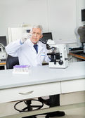 Researcher Analyzing Microscope Slide In Lab — Stock Photo