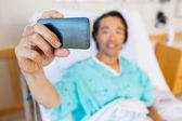 Patient Taking Self Portrait Through Mobile Phone In Hospital — Stock Photo