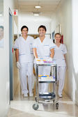 Technicians With Medical Cart Walking In Corridor — Stock Photo
