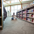 Stock Photo: Student With Stack Of Books In Library