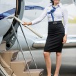 Stewardess Standing On Ladder Of Private Jet — 图库照片
