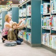 Boy With Teacher Selecting Books From Bookshelf — Stock Photo