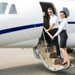 Stewardess And Pilot Boarding Private Jet — Stock Photo