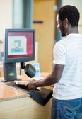Librarian Scanning Books At Bookstore Counter — Stock Photo
