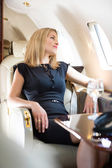 Woman Looking Through Private Jet's Window — Stock Photo