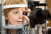 Optician's Hand Checking Boy's Eye With Lens — Stock Photo