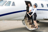 Stewardess And Pilot Boarding Private Jet — Stock Photo