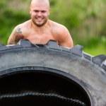 Male Athlete Doing Tire-Flip Exercise — Stock Photo #50084135