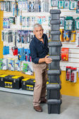 Man Stacking Toolboxes In Hardware Store — Stock Photo