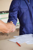 Cropped Image Of Carpenters Greeting — Stock Photo