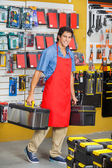 Salesman Carrying Toolboxes While Walking In Store — Stock Photo