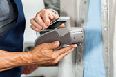 Salesman Accepting Payment Through NFC Technology — Foto Stock